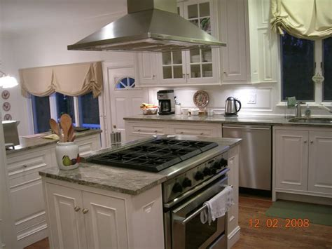 kitchen island with range cupboards on either side of range to an island