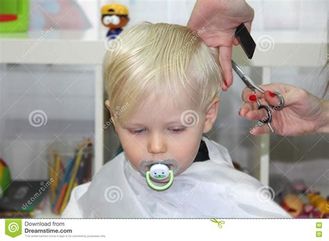 baby boy hairdresser blonde little boy cut their hair in a childrens