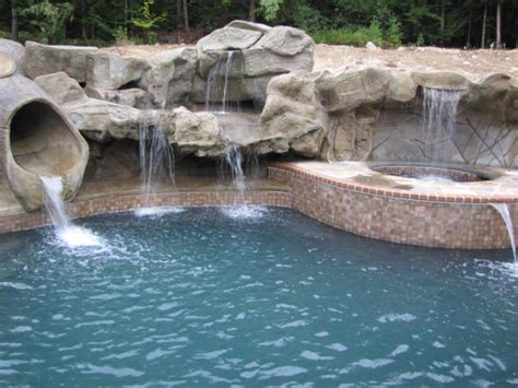 inground pool with waterfall creating a backyard oasis swimming pool waterfalls