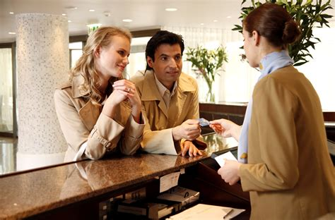Couples Inn Checking In At Hotel Reception Grewal Levy