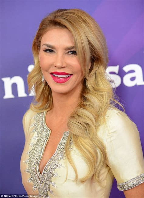 brandi glanville lipstick brandi glanville flaunts her long legs in gold mini dress