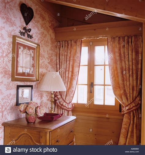 curtains and matching wallpaper window in room with matching curtains and wallpaper in a