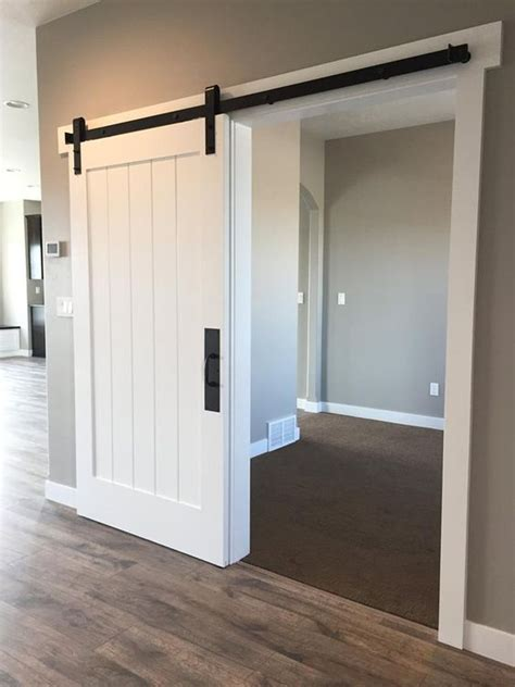 barn closet doors white barn door for the entry closet http www