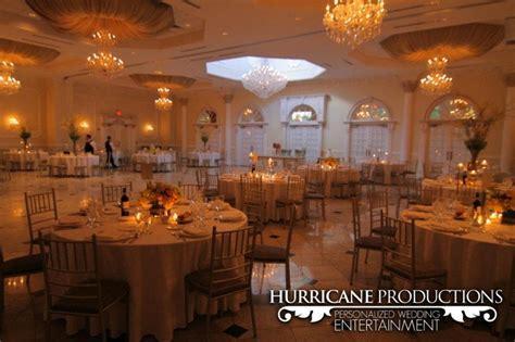 Elegant reception set up using amber and gold dress a room