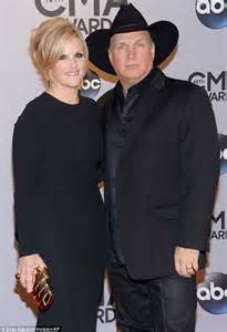 garth brooks and wife trisha yearwood sport matching outfits at the cmas daily mail online
