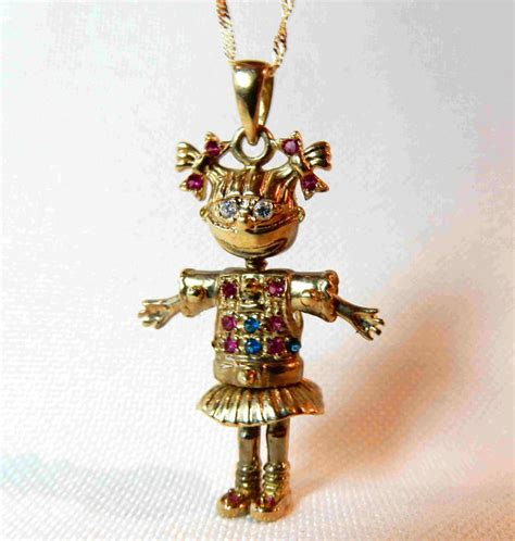 rag doll necklace necklace and pendant in solid gold in the shape of an