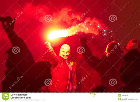 during new year 2015 a masked holding a flare during 2015 new year