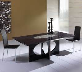Ellipse dining table with base in black lacquered wood and inlays in