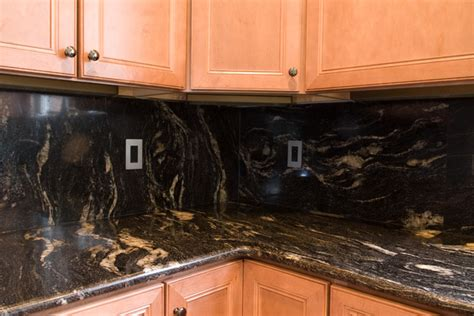 Dark Kitchen Cabinets With Backsplash by Cosmic Black Granite Traditional Kitchen Dc Metro