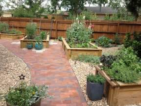 raised beds with brick patio far view outdoor