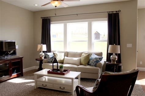 adorable white warm paint color for living room with white sofa and various cushions kitchentoday