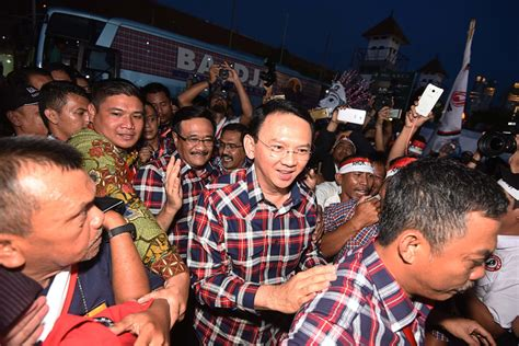 ahok news international armed police guard ahok caign city the jakarta post