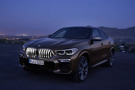 bmw  adds power tech  bold light  grille