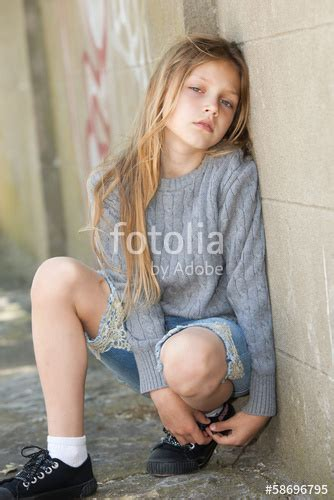 little models xyz quot sad little girl sitting against the wall quot stock photo and