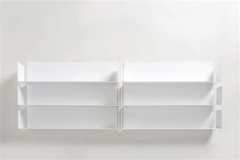 White Wooden Wall Mounted Shelves With Six Racks On The White Wall Mounted Shelves