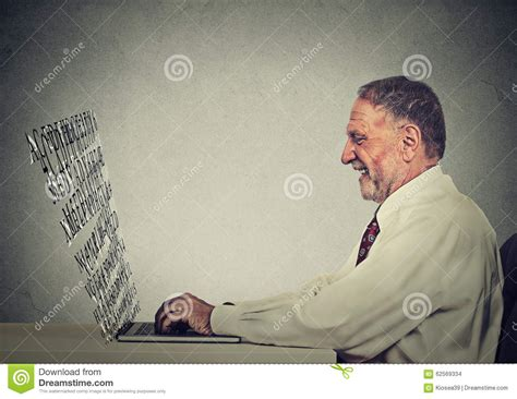 letters from men on both sides of the 1914 christmas truce senior man typing on his laptop computer with screen made
