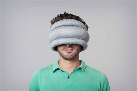 Ostich Pillow by Ostrich Pillow Light Is A Portable Pillow For Napping