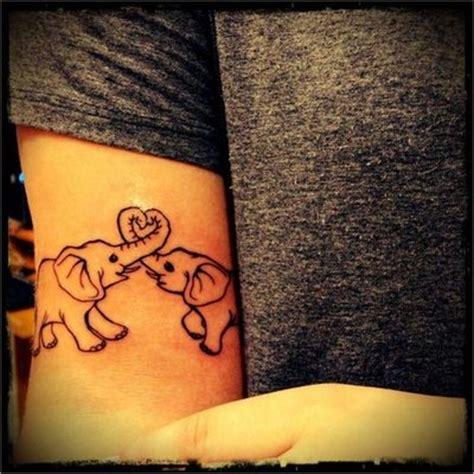 elephant tattoo love elephant love tattoo ideas central