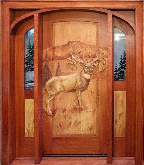 log home exterior doors handcarved mule deer on wooden door photo via web