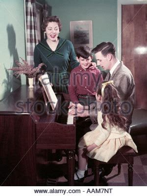 who sang in the boys room 1950s four children singing carols outdoor by lantern stock photo royalty free