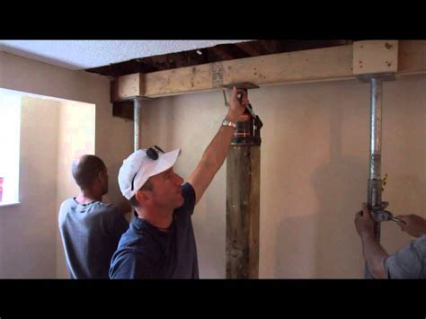 fixing up a house jacking up floor joists episode 171 youtube