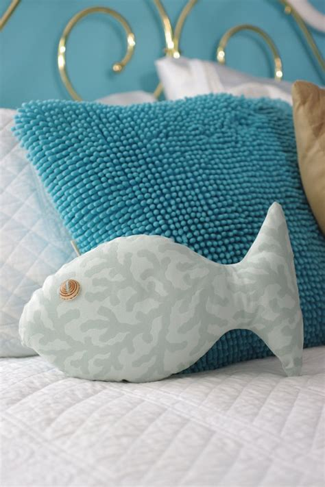 Fish Shaped Pillows by Decor Turquoise Fish Shaped Pillow With Sundial