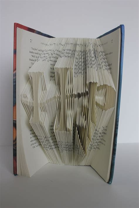 Book Origami Letters - the letters h and p from harry potter in folded book
