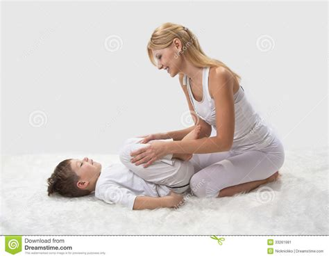 mom son bed mother and son do yoga stock image image of love home