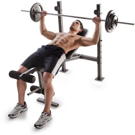 benching at the gym 100 lb weight set and bench gold gym weights lifting