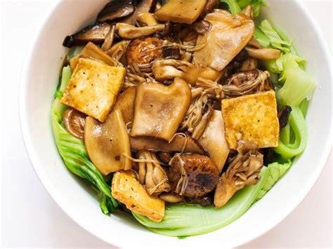 new year food vegetarian mushrooms and tofu with mustard greens recipe