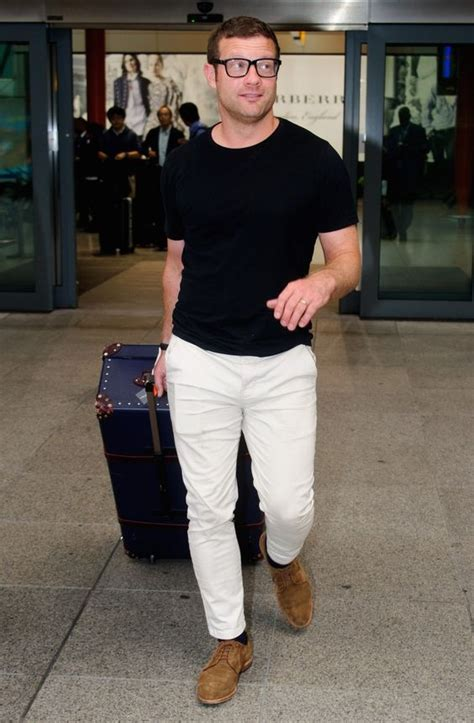 picture of white a black t shirt and brown suede shoes