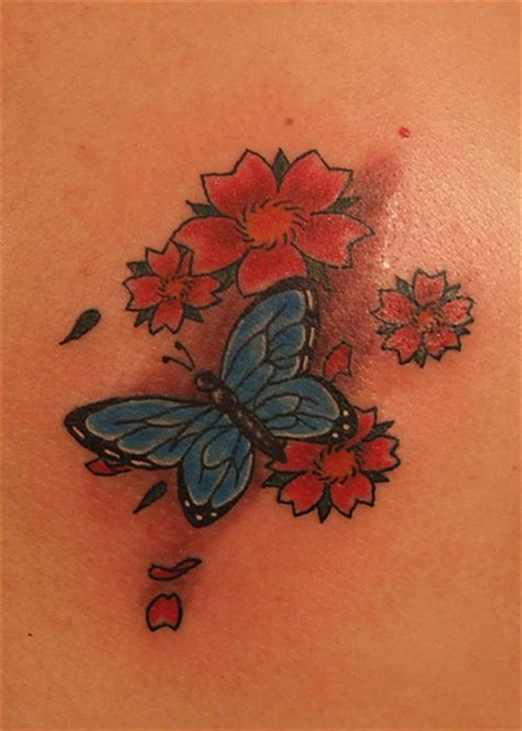 butterfly tattoo cherry blossom butterfly and cherry blossom flowers tattoo a photo on