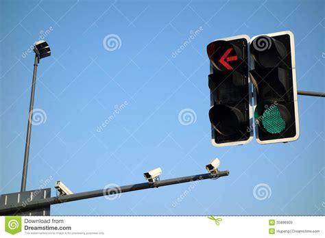blue lights on traffic lights traffic lights with security camera stock image image