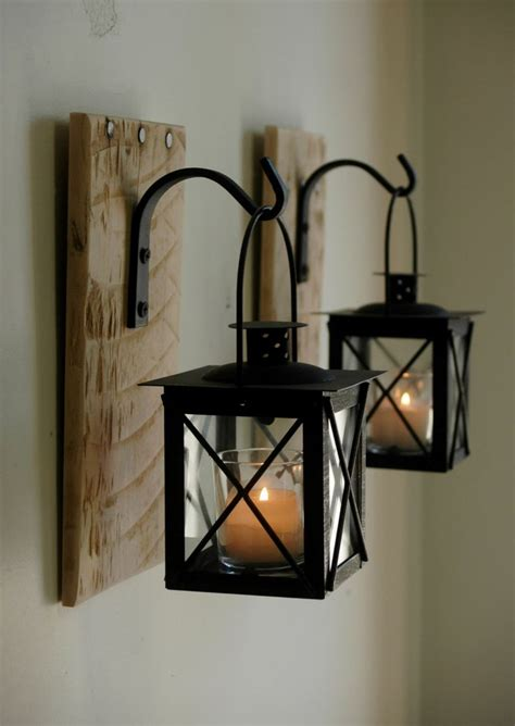 Wrought Iron Home Decor Lantern Pair With Wrought Iron Hooks On Recycled Wood Board For Unique Wall Decor Home Decor