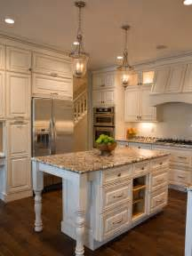 White Kitchen Island Lighting Cottage White And Granite Kitchen With Island Hgtv