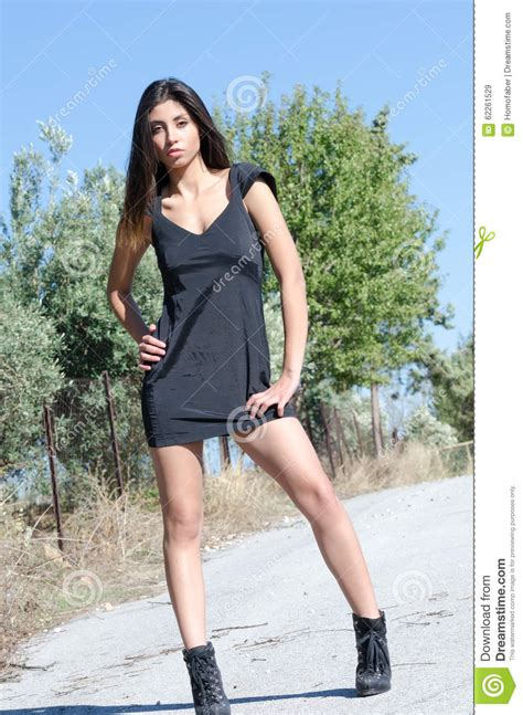 Roadmap To Beautiful Legs by Beautiful Posing On The Rural Road In A Black Dress