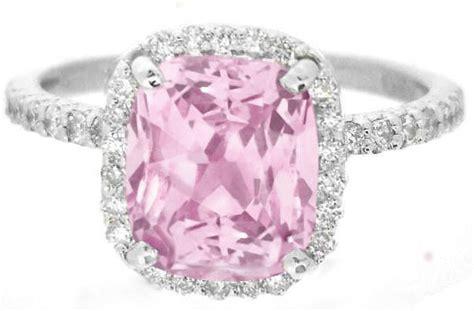light pink sapphire in a cushion cut halo