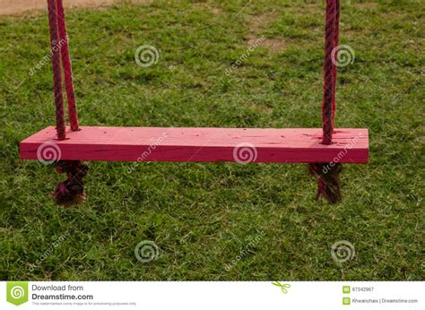 pas grass sign swinging wooden swing with green grass background stock photo