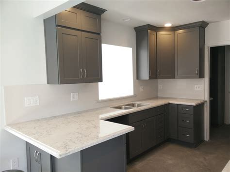gray shaker cabinets with silestone quartz countertop