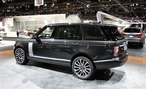 range rover black car and driver