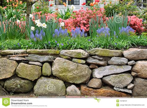 Dry Stone Wall And Colorful Garden Stock Image   Image