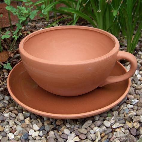 terracotta planter giant tea cup planter internet gardener