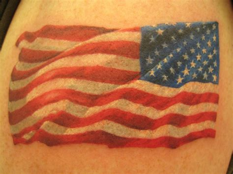 small patriotic tattoos small american flag in wind