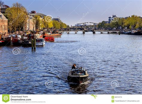 canal sound and light boat on the canal in amsterdam editorial stock photo