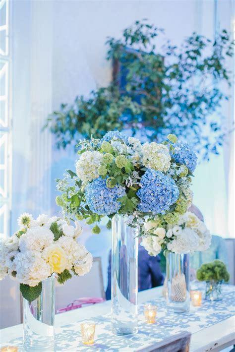 light blue flower arrangements tall blue and white hydrangea centerpieces fox events