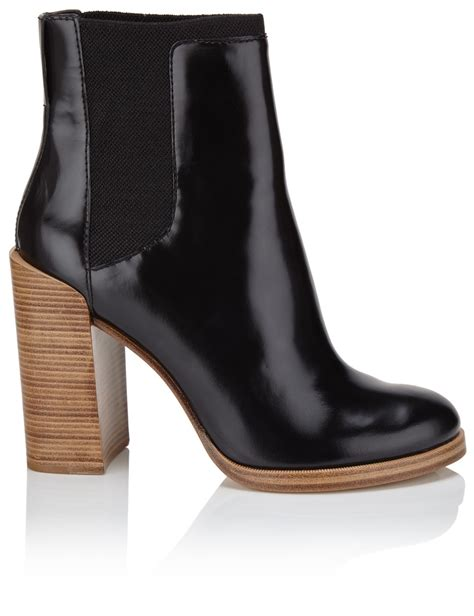 3 1 phillip lim black leather wooden heel boots in black