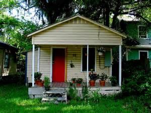 green house red door porch house plants steps red door window green grass