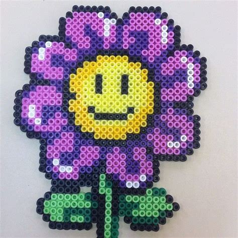 perler bead flower smiley purple flower hama perler perler