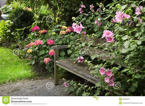 country style garden with bench royalty free stock images
