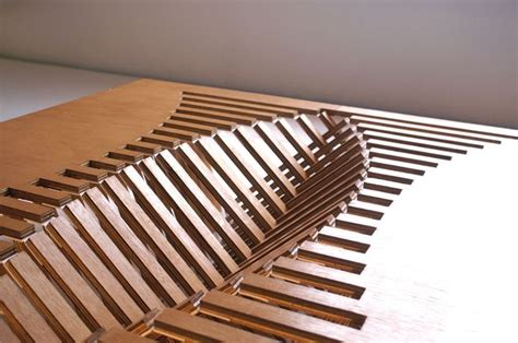 experimental furniture kirigami inspired rising table